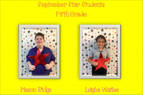 Two students holding stars