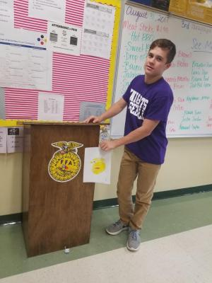 Students made FFA emblems in Ag I class. Blayne Farrington is pictured here with his creation.