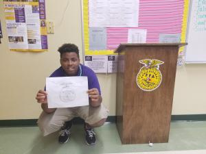 Students made FFA emblems in Ag I class. TyQuendric Lane is pictured here with his creation.