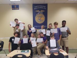 Students made FFA emblems in Ag I class. Pictured here is Austin Hammett, Joshua Talley, Logan McCoy, Christopher Oglee, Karlie Crum, Haylei Beshea, Devin Coleman, Anna Ward, McKenzie Sikes, Gage Green, Trevor Rasbury, Lance Dyer, and Kaylon Lewis.