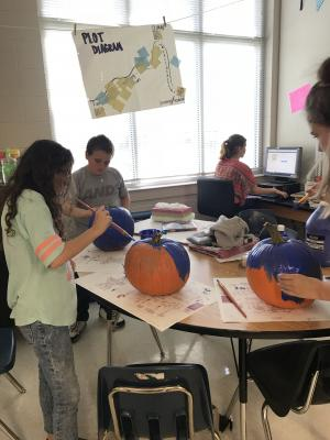 Painting our pumkin globes.