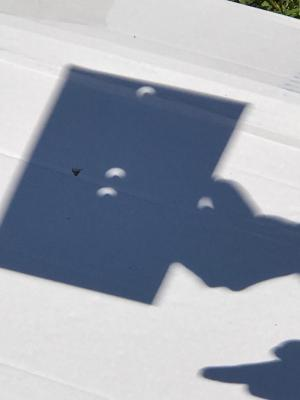 Science:  Experimenting with a safe way to view the eclipse