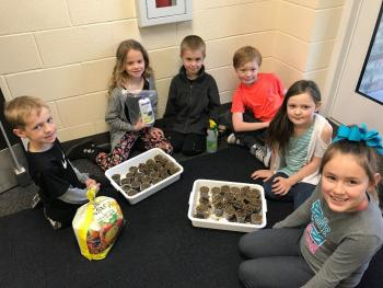 Students with seeds and alfalfa