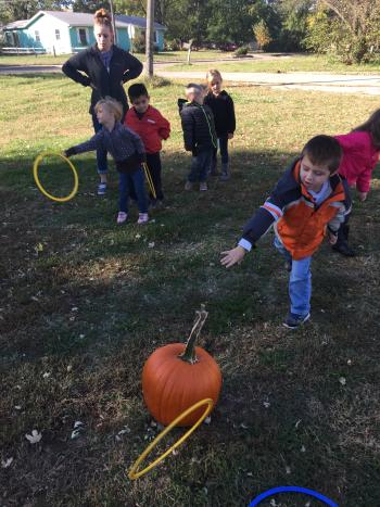 Student Playing Pumpkin ring toss