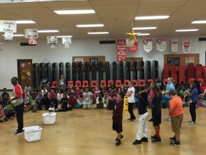 Cooperative activity during an assembly with motivational speaker