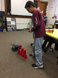 Constructing cup pyramids.