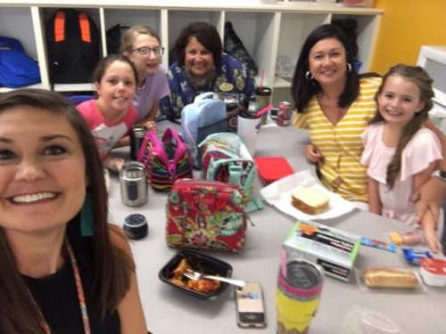 Fourth grade teachers eating with their students