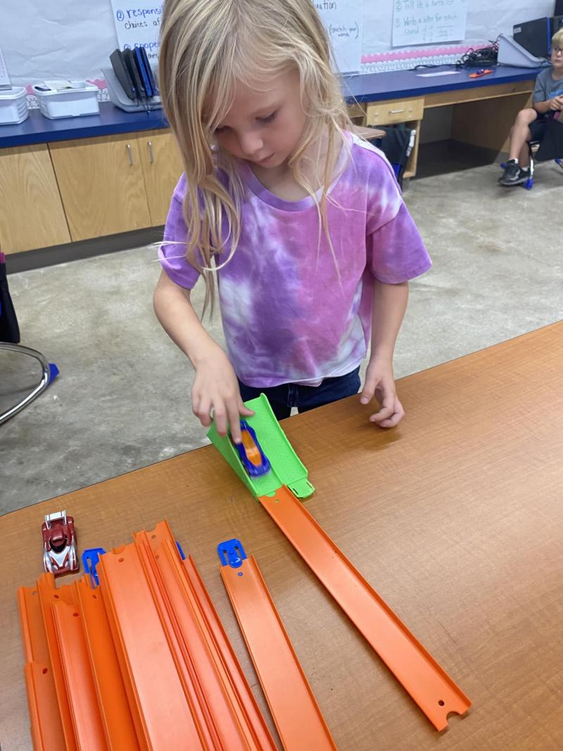 Mrs. Darling's class investigates with Hot Wheels!