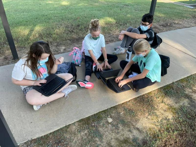 Strategic Reading Classes enjoy working outdoors while identifying and plotting story elements!