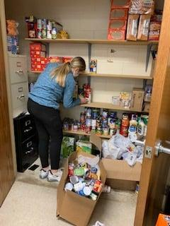 Stocking the GJHS food pantry!