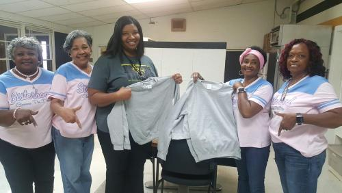 The Nu Chapter Gamma Phi Delta of Tyler makes sweatshirt donation to ORR Campus