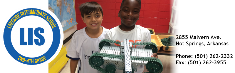 LIS students showing the completion of their robotics project.