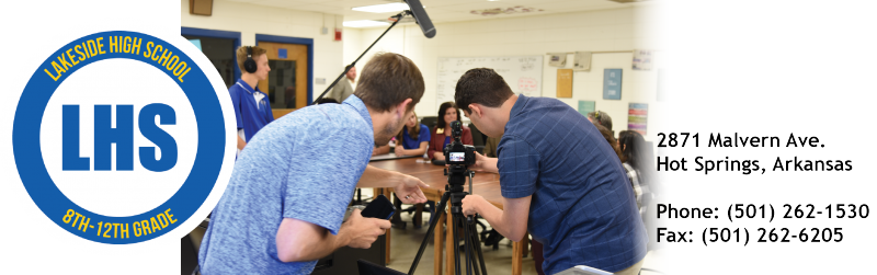 LHS broadcasting team working together to film legislators during round table discussion.