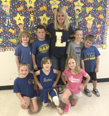 LIS instructor with students in ram gear.