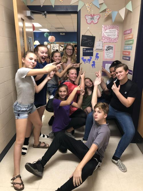 Students showing off the Rams on their homeroom door.