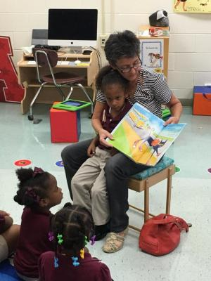 Grandparents reading to students for Grandparents Day