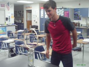 Student pulls hoop hexagon nuts fall in to bottle
