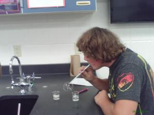 a student blows bubbles