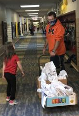 Mr. Lockman and his daughter delivering goodies