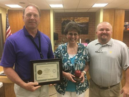Pictured from left to right are Superintendent Dennis Fischer, West Principal Vicki Begin, and Chairman Greg Meyer.