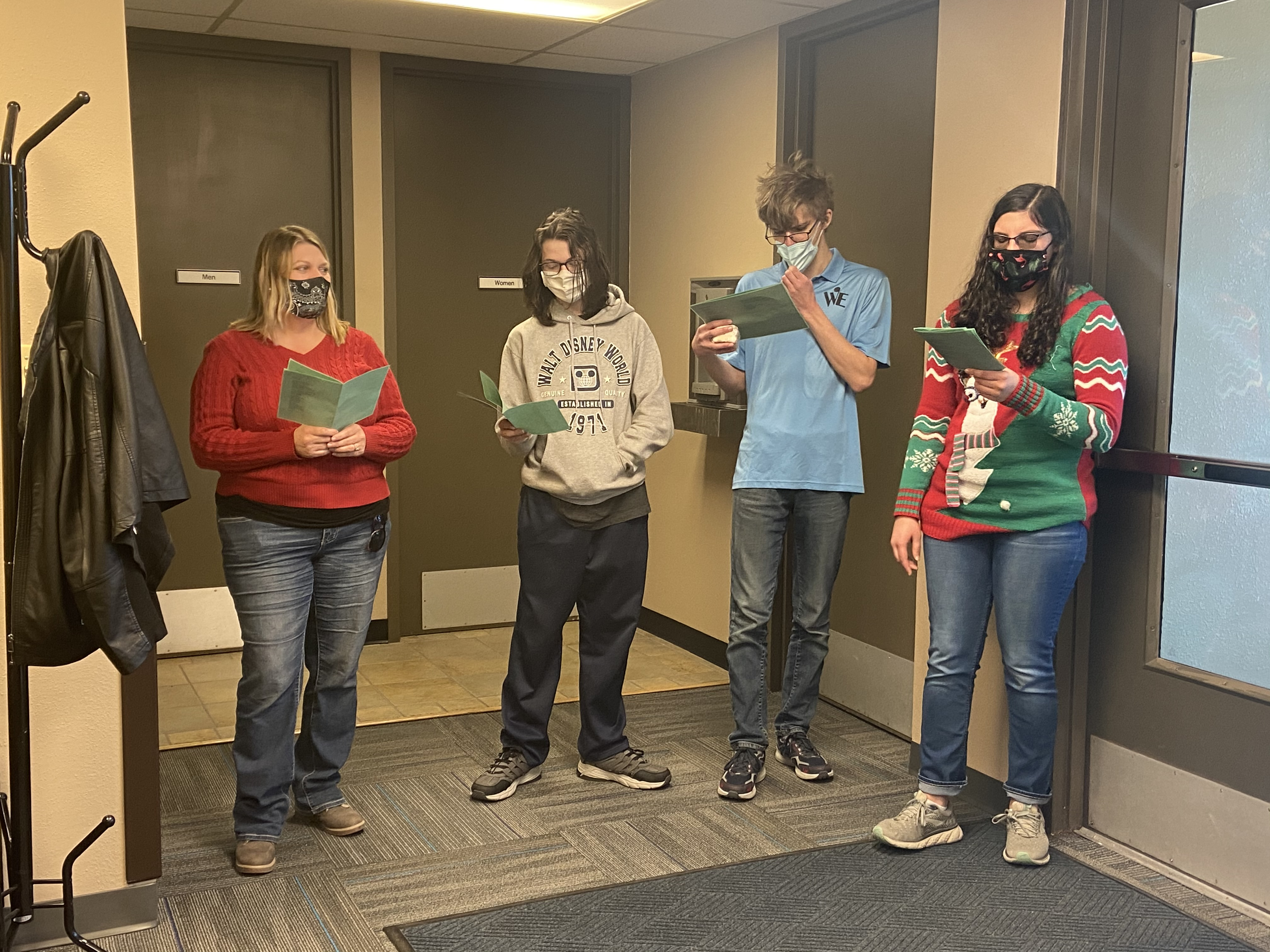 Student carolers spread holiday cheer at the District Office.