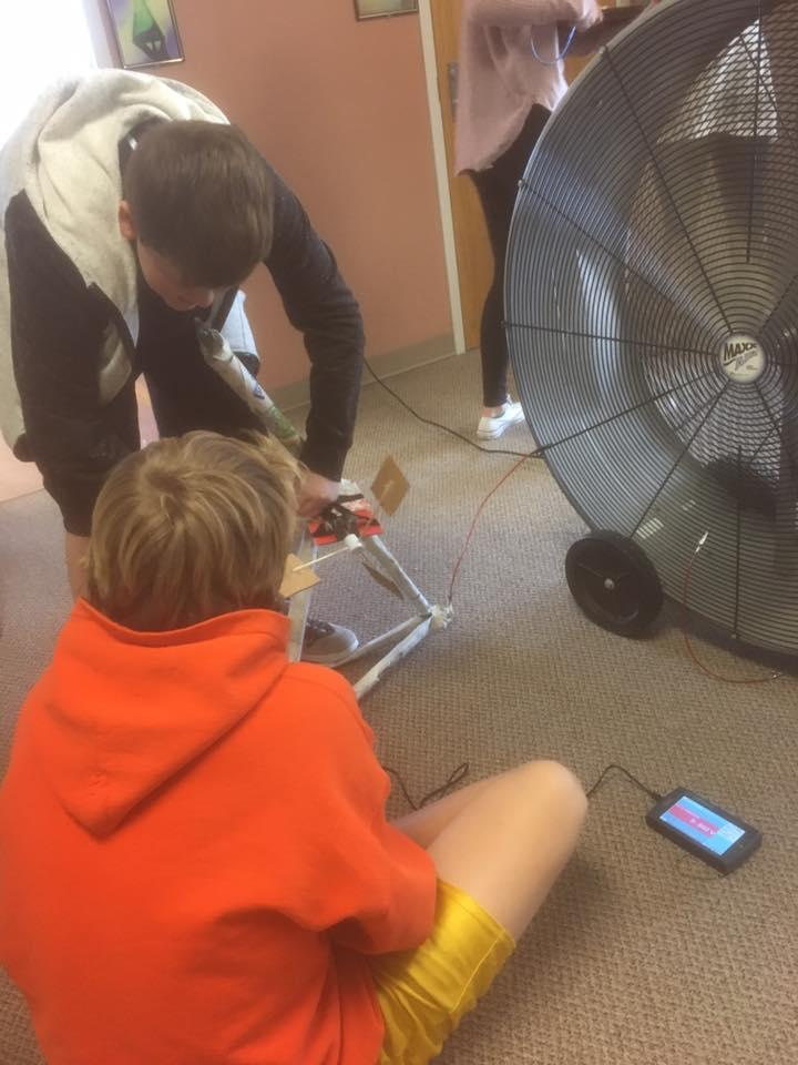 8th Grade students working on their wind-generated Power Towers for Science.