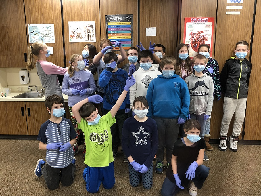 Students moved around their classrooms evaluating different expressions, while wearing masks and gloves to set the mood!