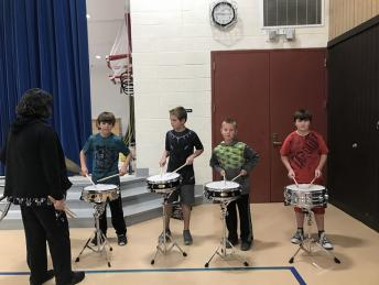 Drum Roll Please!  West students performing for quarterly awards assembly.