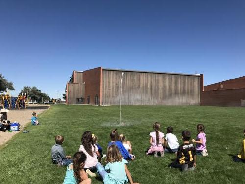 kids shooting off water rockets