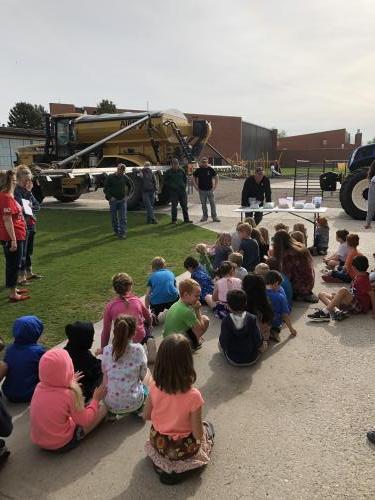 students looking at tractors