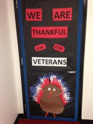 Computer Lab door for Veterans Day.  Elementary students helped make the feathers.