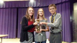 Chamberlain Novice Speech students Shelby Scribner, Emma Morrison, and Mason Boger with the 3rd place sweepstakes trophy won at the Arnett Tournament