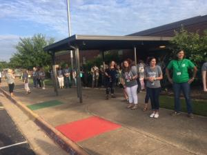 Parents and Teachers , lining the walkway to welcome Students on First day.  Great Day to be a Pirate!!!
