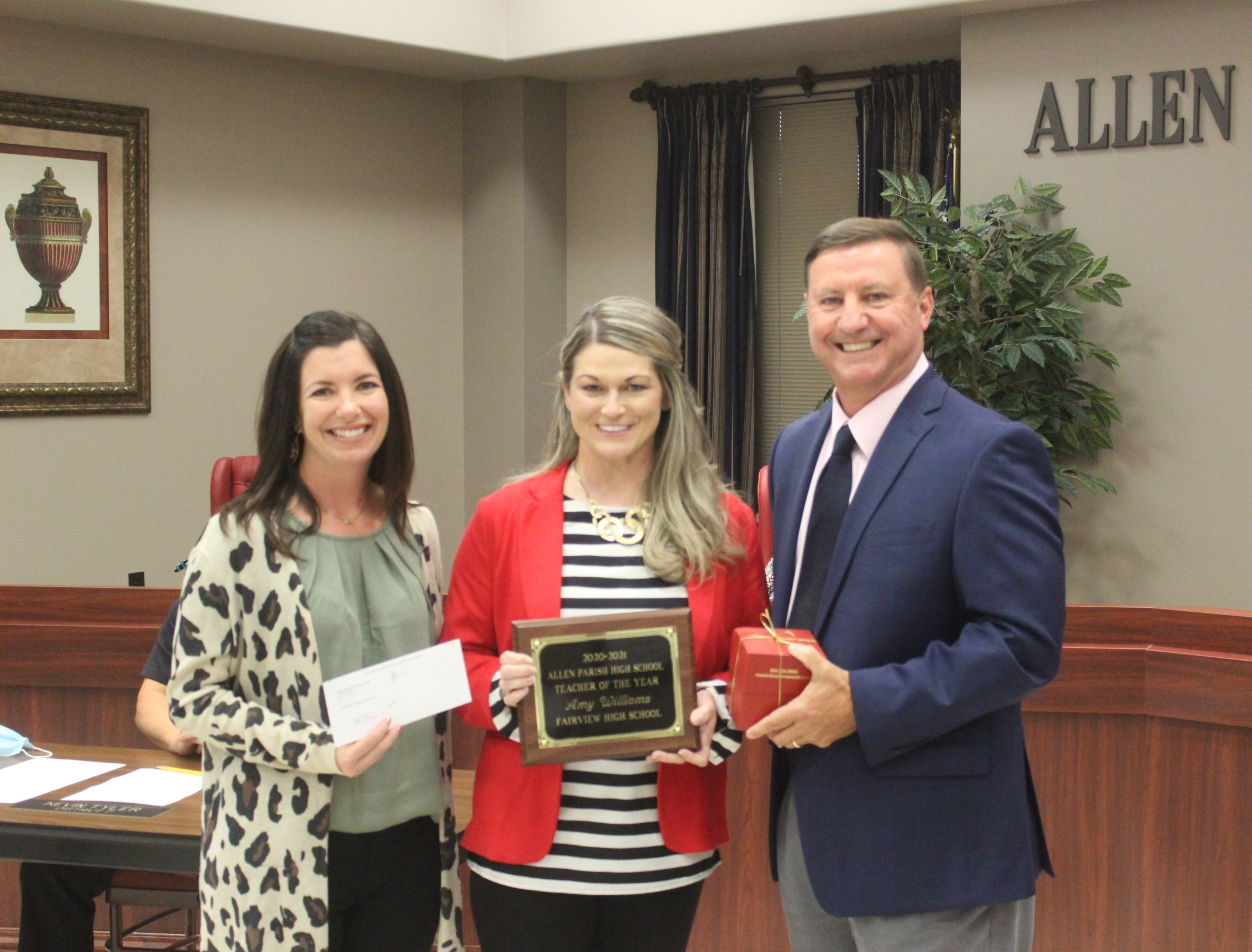 20-21 High School Teacher of the Year Amy Williams, c, with FHS Principal Jade Welch, l, and Superintendent Kent Reed, r