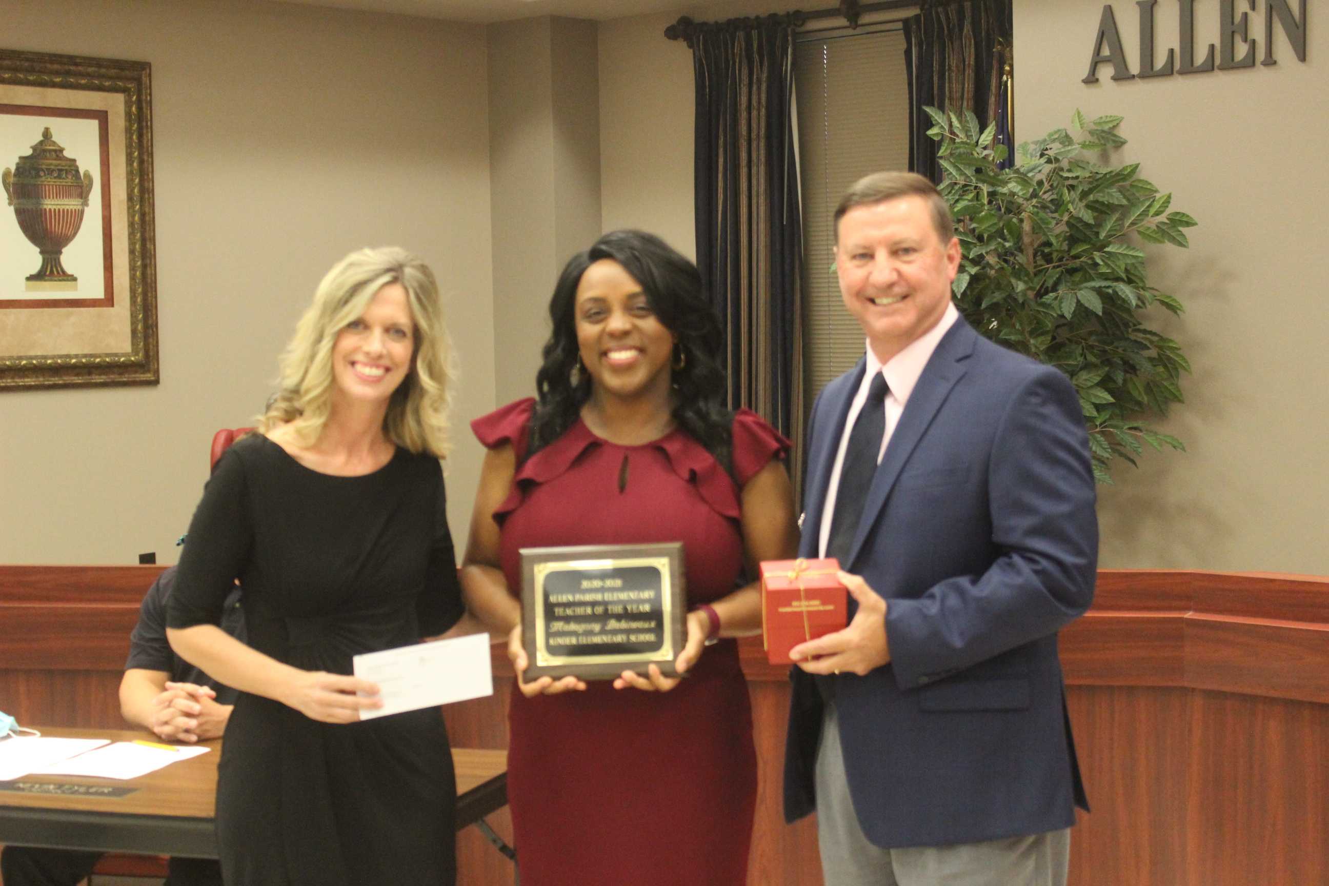 20-21 Elementary School Teacher of the Year Mahogany Babineaux, c, with KES Principal Jennifer Doucet, l, and Superintendent Kent Reed, r