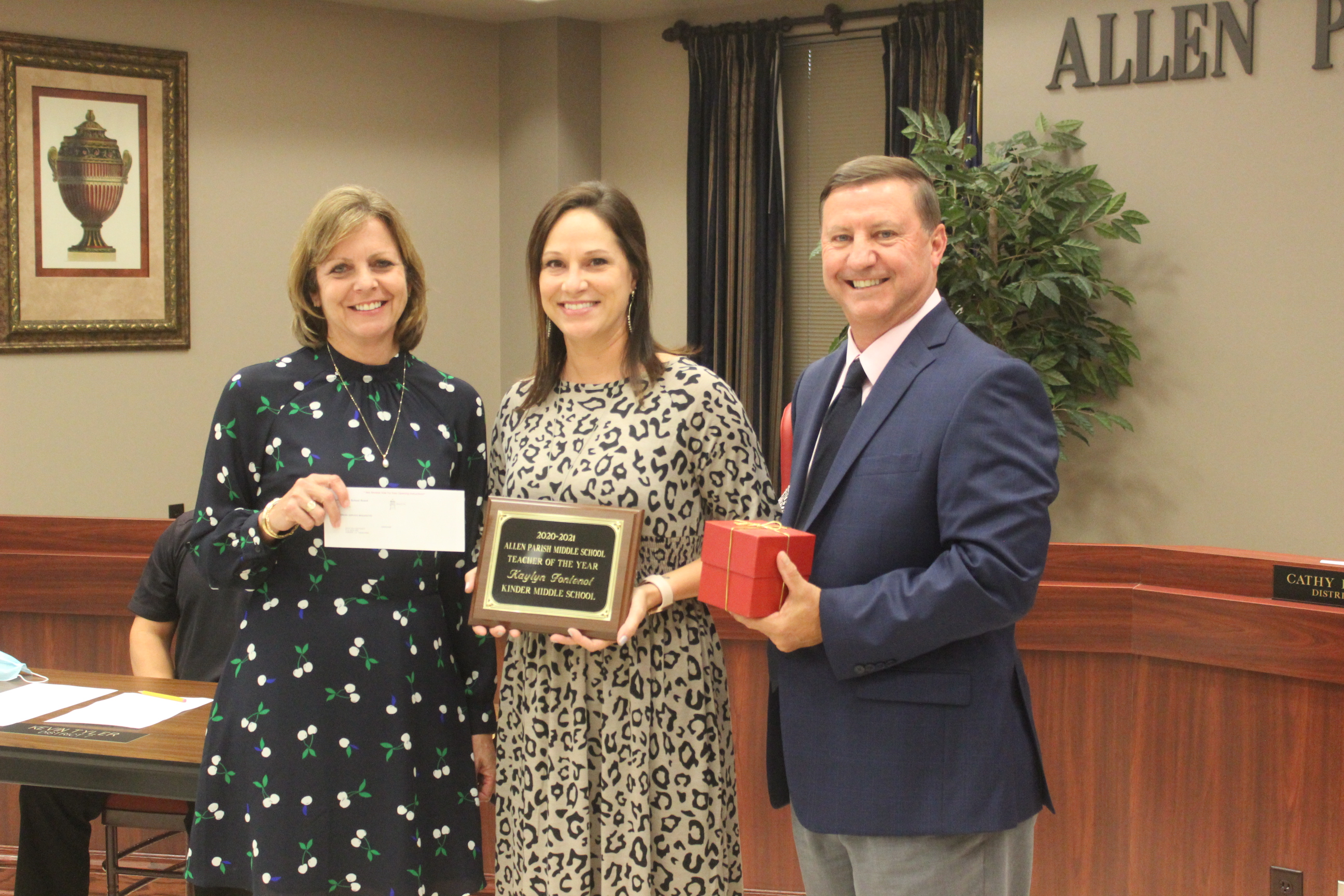 20-21 Middle School Teacher of the Year Kaylyn Fontenot, c, with KMS Principal Marcia Miller, l, and Superintendent Kent Reed, r