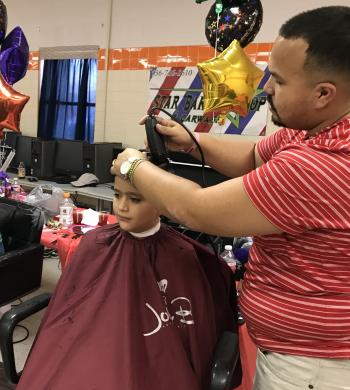 barber school administering free hair cuts
