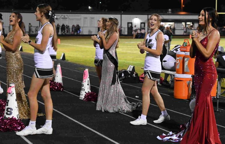cheerleaders leading a cheer during the Tom Bean game