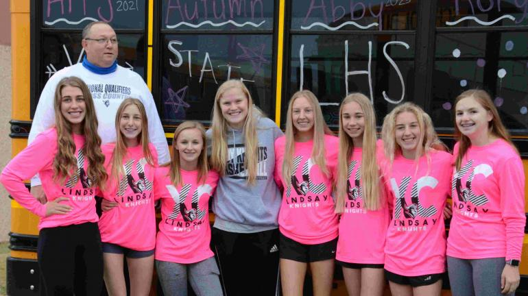 cross country girls and coach Cornelison sendoff to state