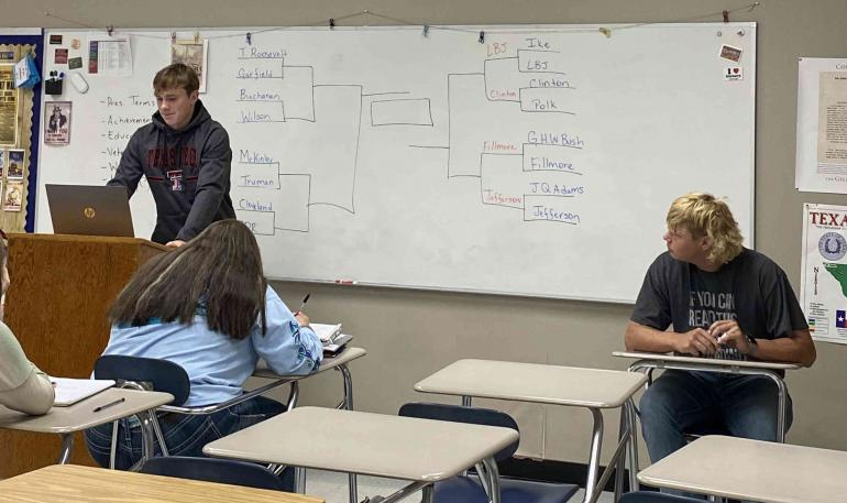Students making a presentation in Branch's class.
