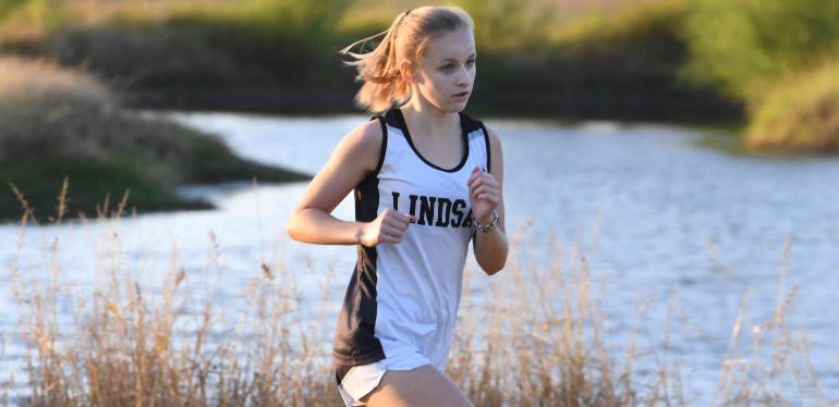 Maya Dulock running at the Nocona cross country meet.