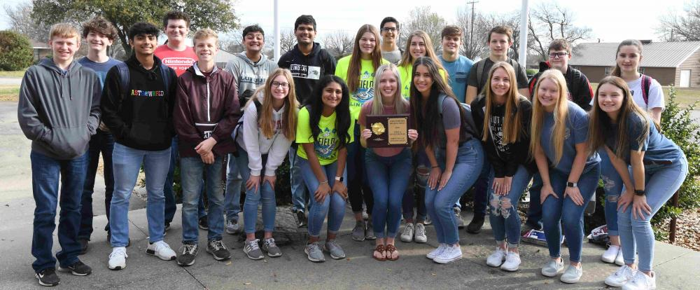 TMSCA group picture with the plaque from Whitesboro