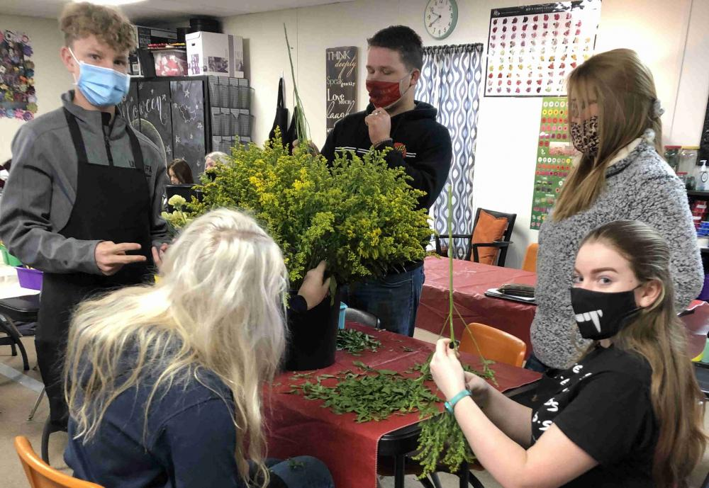 floral design class working on creations