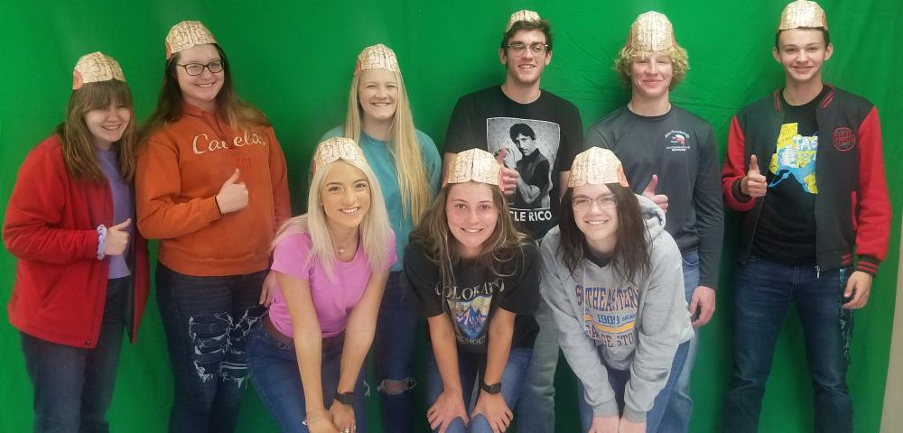 group picture of students wearing brain hats