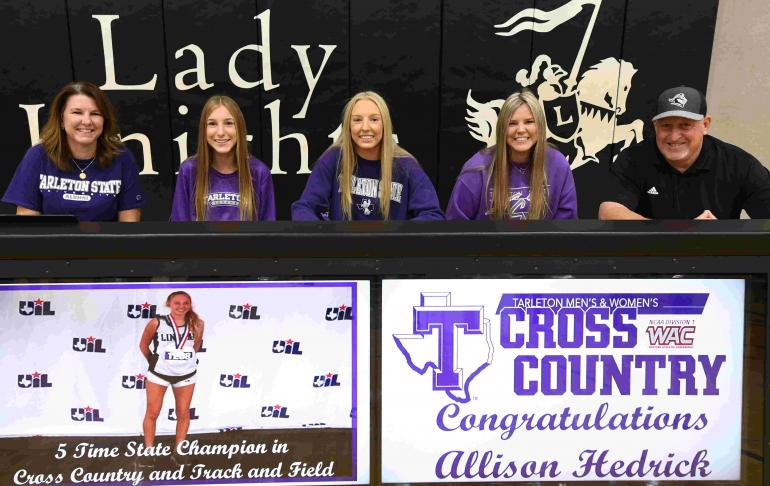 Allison Hedrick with family at college signing.