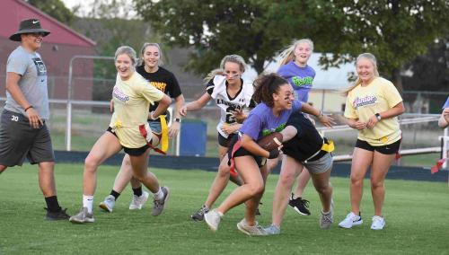 girls running play at powderpuff game