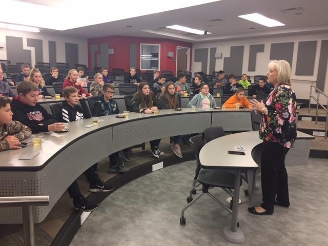 speaker addressing the sixth graders