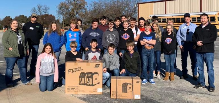 group of students pictured with donated items