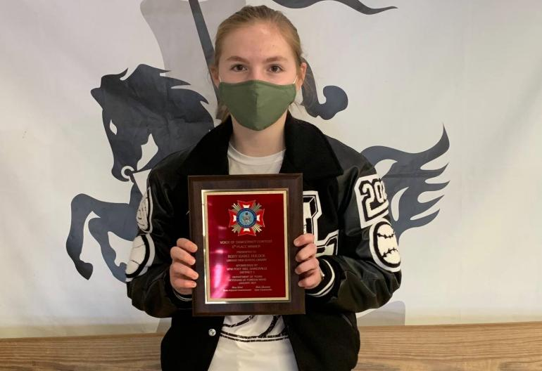 Rory Dulock with the plaque she won for her essay.