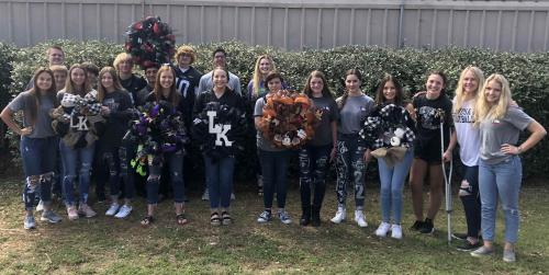 ffa students posing with floral projects